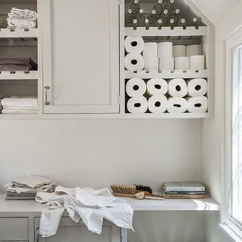 bathrooms - laundry room shelving, laundry room, laundry room storage,  Laundry room with open shelving over cabinets topped with white countertops.