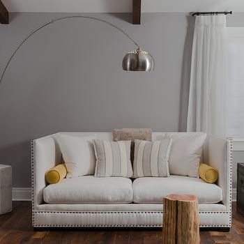 Beckwith Interiors - living rooms - gray walls, yellow and gray living room, arc floor lamp, marble base floor lamp, marble base arc floor lamp, high back sofa, white sofa, studded sofa, white studded sofa, white high back sofa, yellow bolster pillows, rustic wood floors,