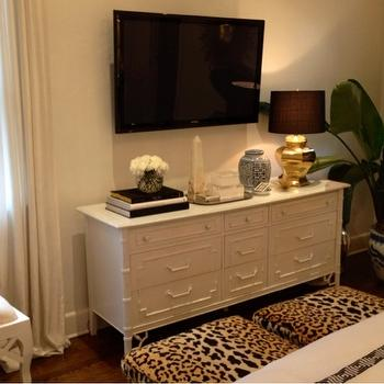 Luxe Report - bedrooms: leopard ottomans, leopard print stools, leopard print ottomans, bamboo dresser, white bamboo dresser, faux bamboo dresser, tv across from bed, bedroom tv, gold faceted lamp,