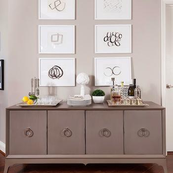 JWS Interiors - dining rooms - diagonal floor, diagonal wood floor, gray sideboard, gray cabinet, gray credenza, gray buffet cabinet, art gallery, abstract art gallery,
