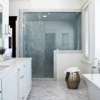Palmer Weiss - bathrooms - bath stool, bathroom stool, metal drum stool, walk in shower, marble moldings, marble trim molding, marble door moldings, marble door trim, marble shower surround, freestanding bathtub, white double vanity sink, his and her sinks, white quartz countertops,