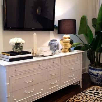 Luxe Report - bedrooms - leopard ottomans, leopard print stools, leopard print ottomans, bamboo dresser, white bamboo dresser, faux bamboo dresser, tv across from bed, bedroom tv, gold faceted lamp, marble obelisk,