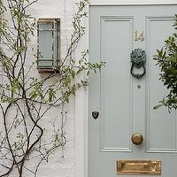 Sarah Barry - home exteriors: white brick home, white brick exterior, gray blue door, gray front door, gray blue front door,  Lovely white brick