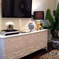 Luxe Report - bedrooms: leopard ottomans, leopard print stools, leopard print ottomans, bamboo dresser, white bamboo dresser, faux bamboo dresser, tv across from bed, bedroom tv, gold faceted lamp, marble obelisk,