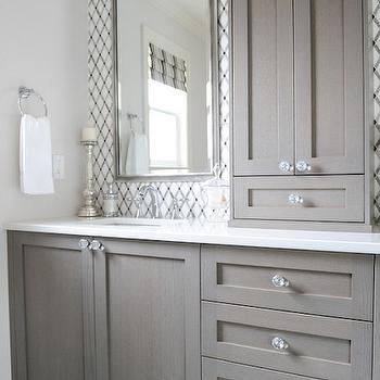 Enviable Designs - bathrooms - gray sink vanity, gray bathroom vanity, gray sink console, crystal cabinet pulls, crystal hardware, white counters, white countertop, undermount porcelain sink, nickel mirror, nickel framed mirror, geometric backsplash tile, lattice backsplash tile, geometric marble tile, marble lattice tile, geometric tiled backsplash, lattice tiled backsplash, gray bathroom, gray and white bathroom, quartz counter, quartz countertop, white quartz counter, white quartz countertop, center console cabinet, gray washed cabinets, gray washed bathroom cabinets, gray washed vanity, gray washed washstand, lattice tiles, white lattice tiles, lattice tile backsplash, white and gray lattice tiles,