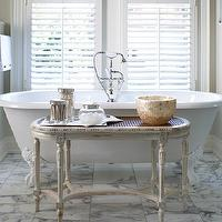 Kimberley Seldon Design Group - bathrooms - traditional bathroom, bathtub in front of window, tub in front of window, bathroom table, bath accent table, oval table, french oval table, oval french table, clawfoot bathtub, white clawfoot bathtub, marble tiled floor,