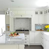 Gorgeous white kitchen with white shaker cabinets accented with nickel hardware ...