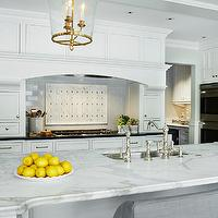 Beautiful kitchen with cabinets painted Benjamin Moore White Dove accented with ...