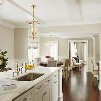 Stunning kitchen with white cabinetry painted Benjamin Moore White Dove accented ...