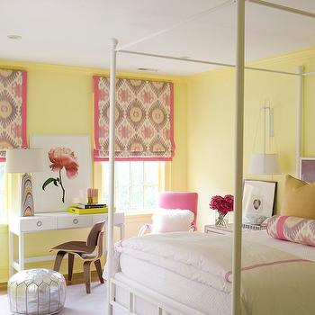 SB Long Interiors - girl's rooms - yellow walls, yellow wall color, yellow and pink kids room, yellow and pink girls room, kids four poster bed, kids canopy bed, white canopy bed, white four poster bed, pink hotel bedding, pink hotel duvet, pink ikat bolster, yellow pillow, fluffy white pillow, monogolian wool pillow, pink chair, pink accent chair, modern desk chair, modern wood chair, silver pouf, silver moroccan pouf, metallic silver moroccan pouf, white desk, contemporary white desk, white desk with ring pull hardware, flower art, flower print, multi colored art, ikat window shades, pink ikat window shade, pink ikat roman shade, white wall lamp, wall lamp, white nightstand, cream rug, ivory rug, 4 poster bed, white poster bed, canopy bed, ducduc desk, white lacquer desk, pink and yellow roman shades, yellow paint colors, ikat bolster pillow,
