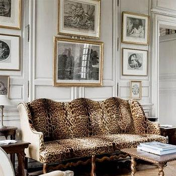 Charles Spada - living rooms - leopard print sofa, leopard print settee, antique leopard print sofa, full wall wainscoting, wainscoting, pale gray wainscoting, raised panel wainscoting, antique prints, antique black and white prints, gallery wall, gilt frame, gold frame, antique black and white art, leopard sofa, leopard couch, leopard settee,