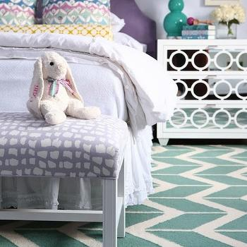 Alisha Gwen - girl's rooms - purple headboard, arched purple headboard, upholstered purple headboard, bench at foot of bed, bench at end of bed, lavender and white bench, lavender bench, teal geometric rug, teal and white geometric rug, teal chevron rug, white mirror front nightstand, white geometric mirrored nightstand, white mirrored nightstand, white nightstand with mirrored drawers, white bedding, white bed linens, pastel colored pillow, multi colored pillow, teal table lamp, teal gourd lamp, teal double gourd lamp, teal and purple bedroom, teal and purple kids room, teal and purple girls room, teal rug, teal geometric rug, white mirrored chest, white mirrored nightstand,
