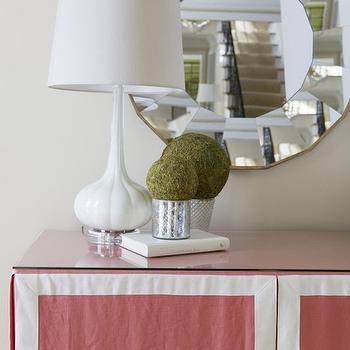 Alisha Gwen - living rooms - round mirror, round mirror framed mirror, round faceted mirror, white glass lamp, white lamp, glossy white lamp, mercury glass pots, mercury glass plant pot, moss ball, pink skirted console table, pink skirted console with grosgrain trim, grosgrain trimmed skirted console table, skirted console, skirted console table, Milano Snow Glass Lamp,