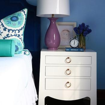Alisha Gwen - girl's rooms: purple lamp, purple ceramic lamp, white nightstand, light blue walls, light blue wall color, navy blue headboard, navy blue velvet headboard, navy velvet headboard, suzani pillow, blue and green suzani pillow, teal bolster pillow, white bedding, white bed linens, teal suzani pillow, white three drawer nightstand, white 3 drawer nightstand, modern white nightstand, white nightstand with gold ring pulls, framed kids art, kids art, alarm clock, silver alarm clock, blue and white rug, blue and white striped rug, striped rug,