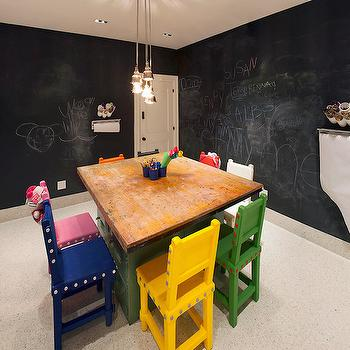 Melanie Morris Design - basements - cluster mini pendant, nickel cluster mini pendant, chalkboard walls, chalkboard playroom walls, chalkboard basement walls, modern yellow kids chair, modern green kids chair, modern blue kids chair, modern pink kids chair, modern kids chair, multi colored kids chair, filing cabinet kids table, green filing cabinet table, play table with filing cabinets, filing cabinet play table, tiled floors, tiled playroom floors, basement playroom, playroom, playroom ideas, desk on filing cabinets, filing cabinet desk, chalkboard walls,