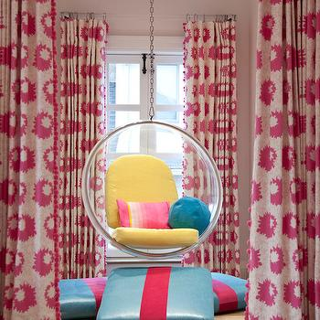 Melanie Morris Design - girl's rooms - modern pink floral drapes, modern pink and white drapes, pink and white drapes, pink and white patterned drapes, pink drapes with pom pom trim, pom pom tassel drapery trim, hardwood floors, acrylic bubble chair, hanging acrylic bubble chair, yellow seat cushions, round teal pillow, retro pink pillow, turquoise and hot pink floor pillow, striped floor pillow, hanging acrylic chair, bubble chair, hanging bubble chair, curtains with pom pom trim, drapes with pom pom trim, pink floral curtains,