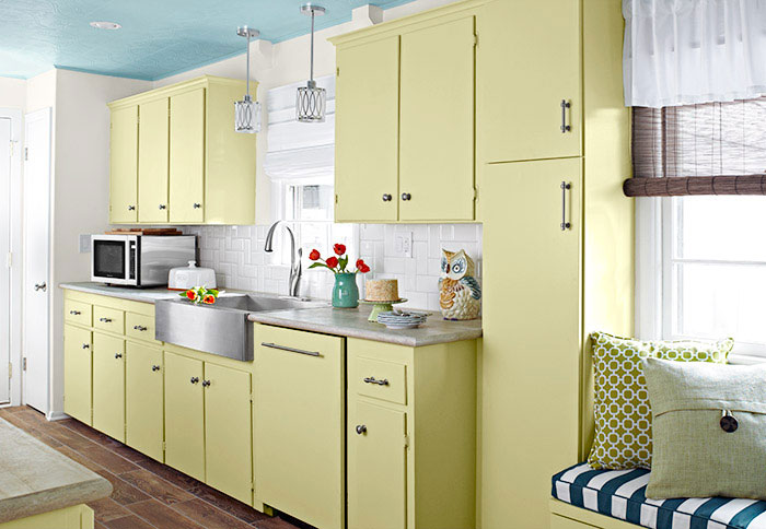 ceiling, yellow kitchen, yellow kitchen cabinets, flat front cabinets