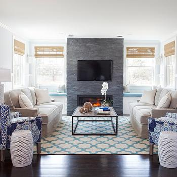 Christopher Home Furnishings - living rooms - fireplace window seats, window seats fireplace, built in window seats, window seat with storage, window seat storage, window seat drawers, floor to ceiling fireplace, gray stone fireplace, modern gray stone fireplace, fireplace tv, fireplace tv niche, fireplace flatscreen niche, turquoise bench cushions, bench cushions, face to afce sofas, gray velvet sofa, industrial coffee table, sofas facing each other, trellis rug, moroccan trellis rug, turquoise trellis rug, turquoise moroccan trellis rug, peacock chairs, peacock accent chairs, blue peacock chairs, half paneled walls, living room paneling, Mother of Pearl Column Table Lamp on Lucite Base,