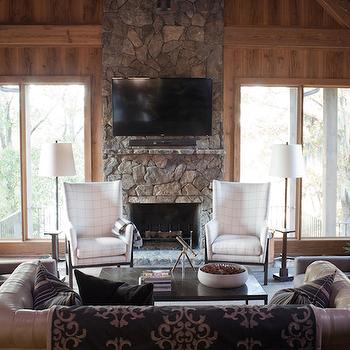 Summer House Style - living rooms - sunroom, sunroom ideas, rustic sunroom, cabin sunroom, country sunroom, country cabin sunroom, sunroom with vaulted ceiling, vaulted ceiling sunroom, barn board sunroom, barn board ceiling, barn board walls, ceiling height fireplace, stone fireplace, sunroom fireplace, rustic fireplace, sunroom tv, wingback chairs, white wingback chairs, floor lamps, espresso coffee table, face to face chairs, brown armchairs, brown slipcovered chairs, gray leather sofa, gray leather tufted sofa,