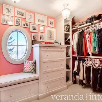 Veranda Interiors - closets - pink walls, pink wall color, bubblegum pink walls, pink and white closet, pink closet, closet built ins, built in shelves, built in shelving, clothes rails, double hung clothes rails, built in closet shelving, closet shelves, closet shelving, closet window seat, window seat, built in dresser, closet dresser, closet tall boy, closet window, oval shaped window, oval shaped closet window, oval window, gallery wall, crystal hardware, black closet door, black glass paned closet door, custom closet, walk in closet, walk in wardrobe, tall boy dresser, pink walk in closet, closet window seat, window seat closet,