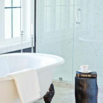 Jillian Harris - bathrooms - clawfoot tub, clawfoot bathtub, bathroom stools, bathroom table, black and white bathtub, black and white tub, herringbone floor, glass walk in shower, mosaic marble shower surround, black stump table, black tree stump stool, black tree stump stool,