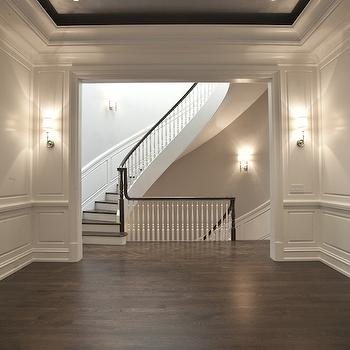PLD Custom Homes - living rooms: black ceiling, tray ceiling, black tray ceiling, living room paneling, paneled living room, curved staircase, winding staircase,