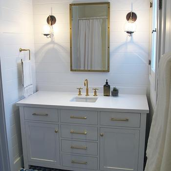 Amber Interiors - bathrooms: caesarstone pure white, caesarstone quartz, caesarstone quartz countertops, pure white quartz, pure white quartz counters, pure white quartz countertops, caesarstone pure white quartz, caesarstone pure white quartz counters, caesarstone pure white quartz countertops, caesarstone pure white counters, caesarstone pure white countertops, rivet mirror, rivet medicine cabinet, brass rivet mirror, brass rivet medicine cabinet, gold faucet, gold vanity faucet, kohler faucet, brushed gold faucet, kohler brushed gold faucet, tongue and groove, paneled bathroom, bathroom paneling, glass and rope sconces, brass hardware, brass pulls, brass cabinet pulls, brass knobs, white and blue tiles, blue geometric tiles, white and blue tiled floor, brushed gold towel ring, brushed gold knobs, brushed gold fixtures, brushed gold bath fixtures,