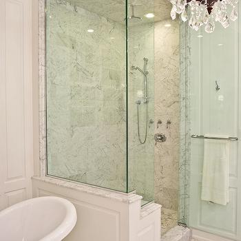 PLD Custom Homes - bathrooms: walk in shower, glass shower, glass walk in shower, seamless glass shower, rain shower head, marble shower surround, paneled shower, claw foot bathtub, bathtub chandelier, master bathroom chandeliers,