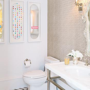 Lonny Magazine - bathrooms - contemporary powder room, framed skateboards, accent wall, powder room accent wall, wallpapered accent wall, brown geometric wallpaper, french mirror, 2 leg washstand, 2 leg sink vanity, chevron tiles, chevron floor tiles, gray chevron tiles, gray chevron floor, powder room art,