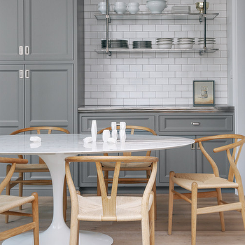 Lonny Magazine - kitchens - grey cabinets, grey kitchen cabinets, grey shaker cabinets, grey shaker kitchen cabinets, grey kitchen, kitchen subway tiles, subway tiles with grey grout, hanging shelves, glass hanging shelves, oval dining table, wishbone dining chairs,