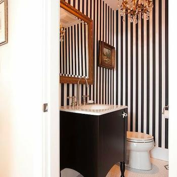 HGTV - bathrooms - powder room, black and white powder room, powder room ideas, striped powder room, black and white striped powder room, vertically striped walls, vertical striped walls, gilt mirror, black vanity, black single vanity, black washstand, black vanity white countertop, black washstand white countertop, vintage hex tiles, vintage hex floor, powder room chandelier,