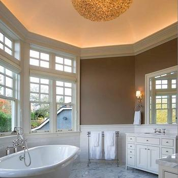 LeeAnn Baker Interiors - bathrooms - curved bath, curved bathroom, curved master bath, curved master bathroom, tiled half wall, half wall tiles, bathtub under window, freestanding bathtub, his and her vanities, his and her washstands, beveled mirror, white beveled mirror, vanity mirrors, freestanding towel rack, white marble floor, vaulted ceiling, bathroom vaulted ceiling, vaulted ceiling bathroom,