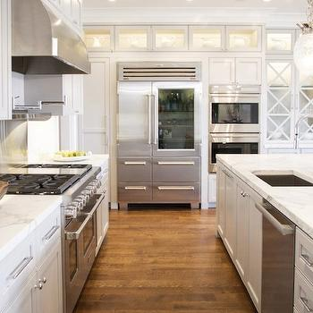 Stunning pale gray cabinets accented with nickel hardware and white marble ...