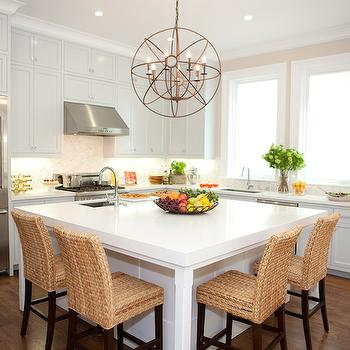 Beautiful L-shaped kitchen with square kitchen island featuring a stainless steel ...
