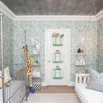 Play Chic Interiors - nurseries - boys nursery, boys nursery ideas, metallic ceiling, silver ceiling, nursery wallpaper, turquoise wallpaper, turquoise floral wallpaper, lucite cubes, lucite bookcase, lucite bookshelf, acrylic bookcase, acrylic bookshelf, toy storage, toy storage ideas, nursery bookcase, nursery bookshelf, iron crib, canopy crib, iron canopy crib, mirror over crib, mirror above crib, gray striped rug, nursery giraffe, indoor porch swing, porch swing, nursery swing, swing sofa, nursery swing sofa, nursery sofa, gray linen pillows, beaded sconces, silver curtains, silver drapes, silver drapery, silver pillows, metallic pillows, silver metallic pillows,