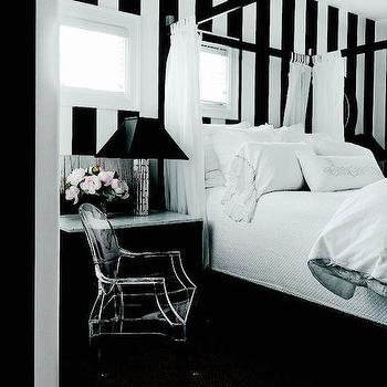 bedrooms - black and white room, black and white bedroom, off set windows, striped walls, black and white striped walls, vertical stripe walls, vertical striped walls, vertically striped walls, bedroom wall stripes, bedroom striped, striped on bedroom walls, stripes on walls, black canopy bed, tall bed, high bed, black nightstands, marble top nightstand, black lamp sahdes,
