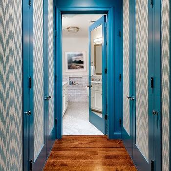 Tilton Fenwick - closets - mirrored door, chevron wallpaper, turquoise chevron wallpaper, blue chevron wallpaper, wallpapered doors, wallpaper on doors, blue moldings, blue door moldings,