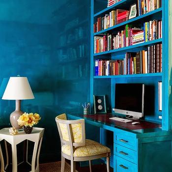 Tilton Fenwick - dens/libraries/offices - turquoise walls, lacquer walls, lacquered walls, turquoise lacquer walls, turquoise lacquered walls, turquoise shelves, turquoise bookcase, turquoise bookcase, turquoise desk, end table, cut out end table, light gray lamp,