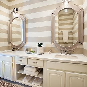 Tracy Hardenburg Designs - bedrooms - striped walls, horizontal striped walls, striped bathroom walls, ivory sink vanity, built in vanity, dual sink vanity, his and hers sinks, vanity with open shelves, light tiled floors, neutral bathroom, monochromatic bathroom, jute herringbone rug, herringbone natural fiber rug, white counter, white countertop, nickel cup pulls, wood mirror, riveted mirror, black enamel wall sconce, beige and white striped wall, bathroom accent wall, painted backsplash, painted vanity backsplash, striped horizontal walls,