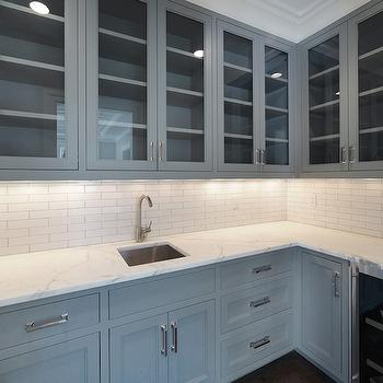 Blue Water Home Builders - kitchens - under cabinet lighting, gray cabinets, gray kitchen cabinets, gray shaker cabinets, gray butlers pantry cabinets, white marble counter, white marble countertop, prep sink, butlers pantry sink, butlers pantry prep sink, stainless steel prep sink, gooseneck faucet, subway tile, subway tiled backsplash, white subway tile, ceiling height cabinets, ceiling height cabinetry, glass front upper cabinets, glass front shaker cabinets, glass front cabinets, glass front wine fridge, wine fridge, butlers pantry wine fridge, butlers pantry cabinets, glass door wine cooler,
