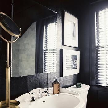 Lonny Magazine - bathrooms - black and white bath, black and white bathroom, black wall panels, paneled bath, paneled bathroom, black paneled bathroom, vertical wall panels, black vertical wall panels, vertical paneling, frameless mirror, pedestal sink, pedestal sink with backsplash, freestanding shaving mirror, antique shaving mirror, brass shaving mirror, antique brass shaving mirror,