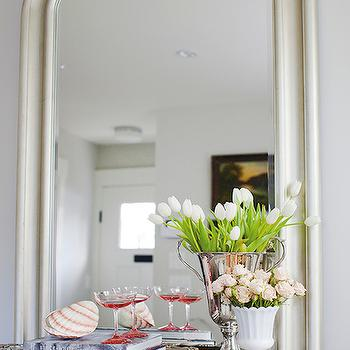 Jillian Harris - entrances/foyers - silver leaf floor mirror, silver leafed floor mirror, arched silver leaf floor mirror, floor mirror behind console table, mirror behind console table, gray demi lune console, distressed gray console, french demi lune console, white milk glass vase, silver trophy, silver trophy vase, silver tray, demi lune console table, antique console table, gray foyer table, gray half moon table, gray deminliune table,
