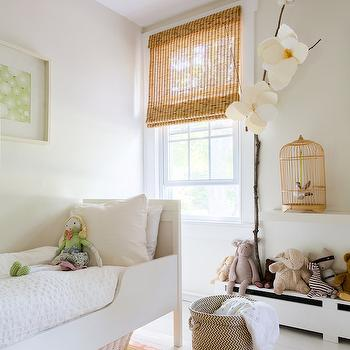 Lonny Magazine - nurseries - gold bird cage, kids room, daybed, kids daybed, wood daybed, white daybed, white wood daybed, white blanket, shadow box, colorful striped rug, kids rug, kids beds, white plank floor,