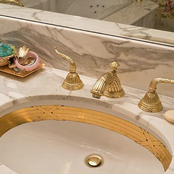 Andrews Design - bathrooms - calcutta ora, calcutta ora marble, calcutta ora marble counters, gilded sink, gold sink, vanity sink, oval sink, oval vanity sink, ornate faucet, brass ornate faucet,