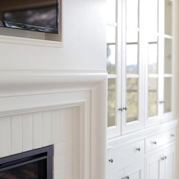 H2 Design and Build - living rooms - fireplace, beveled fireplace mantle, beveled mantle, brick fireplace, white beveled fireplace, white beveled mantle, fireplace niche, flatscreen niche, tv niche, fireplace tv niche, glass front cabinets, fireplace cabinets, fireplace built ins, built in cabinets, fireplace tv, tv fireplace,