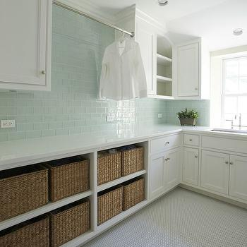 Kelly Deck Design - laundry/mud rooms: green subway tiles, green glass subway tiles, green glass backsplash, laundry room backsplash, white and green laundry room, laundry room ideas, shaker cabinets, laundry room cabinets, open shelving, laundry room shelves, laundry room shelving,