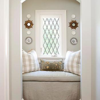BHG - bedrooms - arched window nook, arched window niche, window seat nook, reading nook, gray walls, gray wall color, sunburst mirror, mini sunburst mirror, gilt sunburst mirror, wall plates, leaded glass window, diamond leaded glass window, window molding, window trim, window seat, window seat bench, linen window seat bench, skirted window seat, linen window seat cushion, gray floral velvet pillow, gray plaid pillow, gray buffalo check pillow, reading nooks, arched nooks, reading nook, arched reading nook,