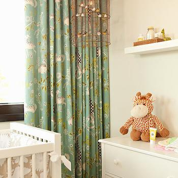 Chris Barrett Design - nurseries - gender neutral nursery, nursery crib, white and beige crib bedding, bird cage chandelier, bird cage pendant, bird cage lantern, shelf over changing table, green patterned curtains, nursery lighting, nursery chandelier, nursery pendant, nursery lantern,