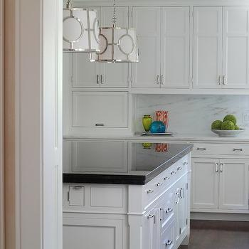 Gorgeous white shaker cabinets with polished nickel cabinet hardware alongside ...