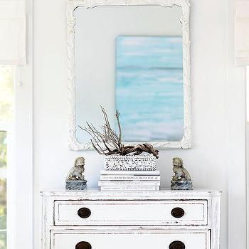 BHG - entrances/foyers - beachy foyer, beach entryway, coastal foyer, coastal entryway, white two drawer chest, distressed white chest, antiqued two drawer chest, stacked books, white shell box, gray foo dogs, foo dogs, branch, branch decor, white mirror, white ornate mirror, white antique mirror, coastal foyer, beach cottage foyer, white distressed chest, whitewashed chest, antique foo dogs, white foyer, white entry,